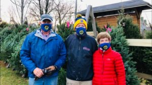 Woody Brown, Kerry Tull, and Sandy Bowieat Yarmouth Lions Club Trees for Tuition